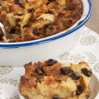Chocolate Croissant Bread Pudding served on a white plate