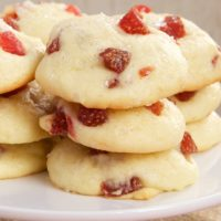 Strawberry Cream Cheese Cookies stacked on a white serving stand