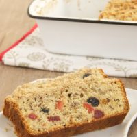 slices of Berry Pecan Streusel Bread on a white plate