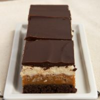 Caramel Crunch Brownies are layer upon layer of good stuff, from caramel to chocolate to nougat. - Bake or Break