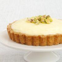 Lemon Cream Tart on a white pedestal