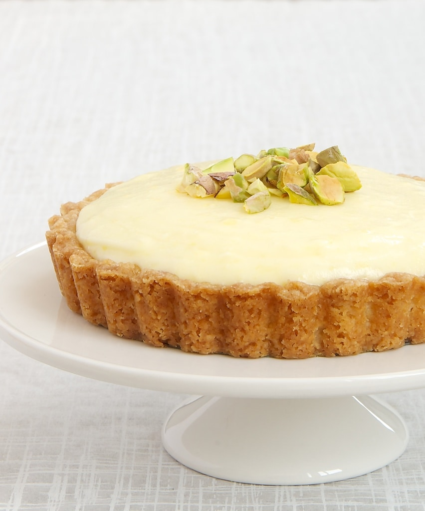 Lemon Cream Tart on a white pedestal
