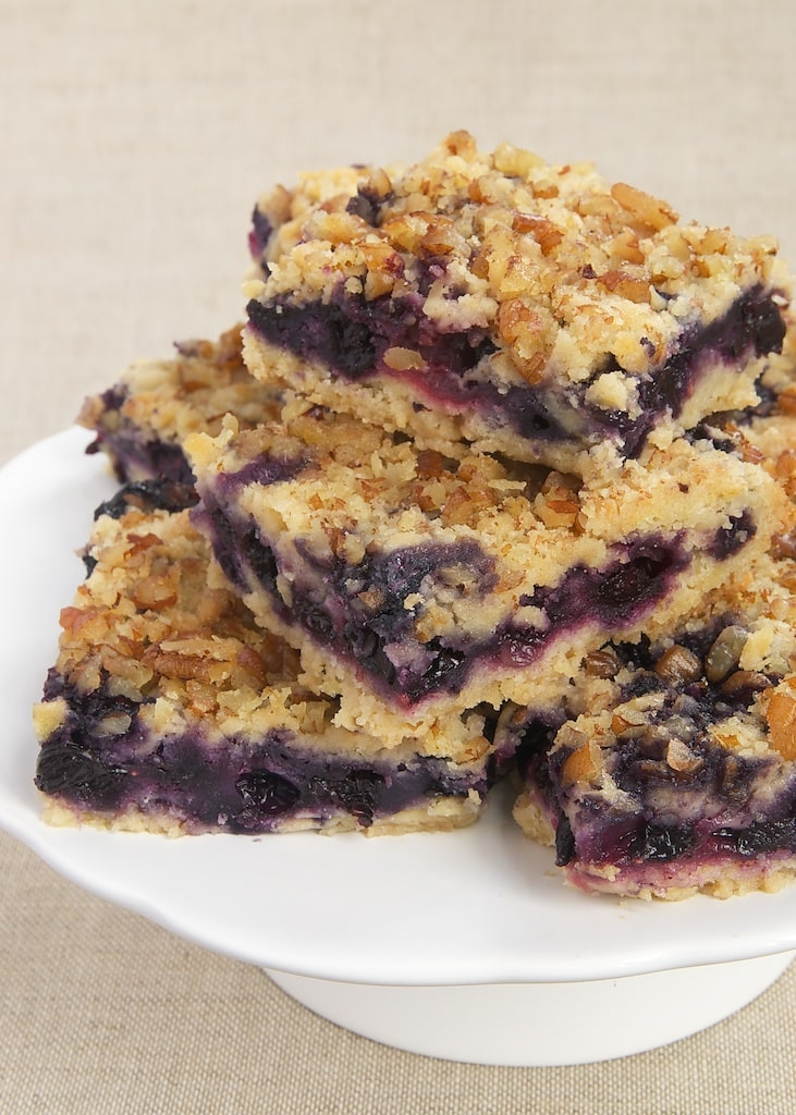 Berry Crumb Bars combine fresh berries with a soft crust and a nutty crumb topping.