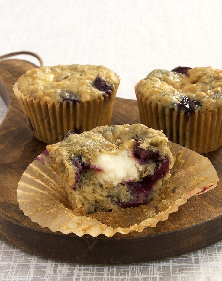 Cherry Cheesecake Muffins on a wooden serving plate