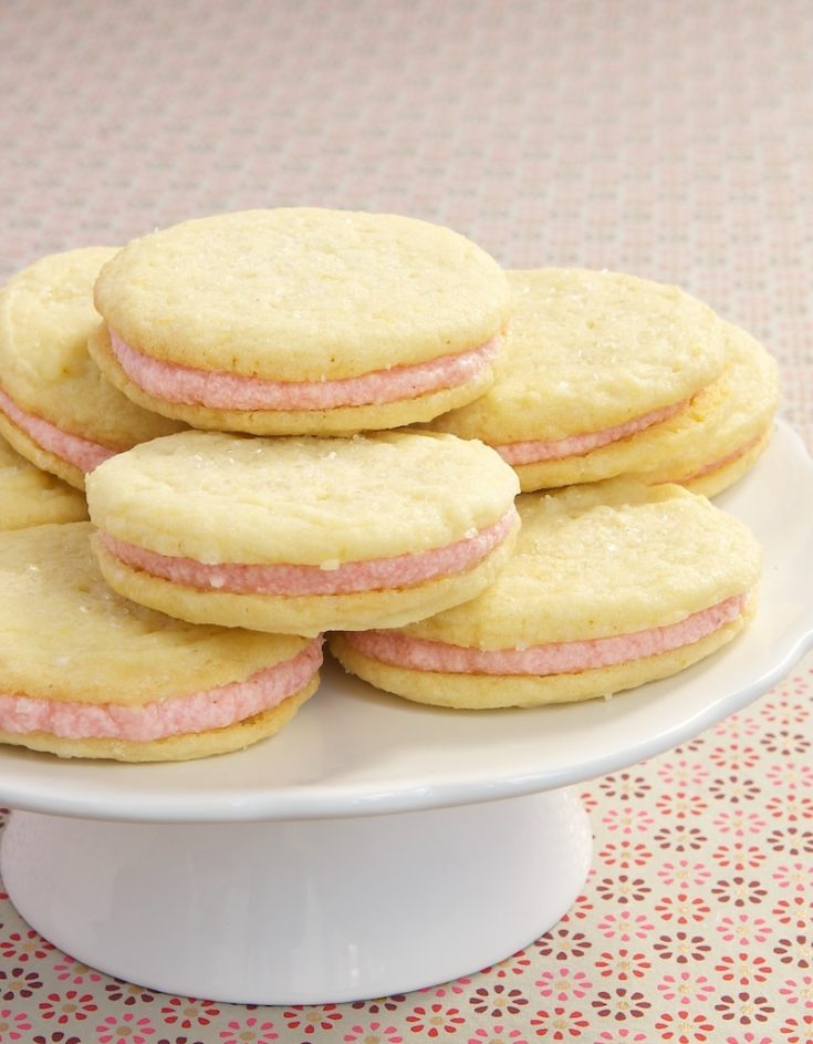 Strawberry-Lemon Sandwich Cookies feature a sweet strawberry filling between soft lemon cookies.