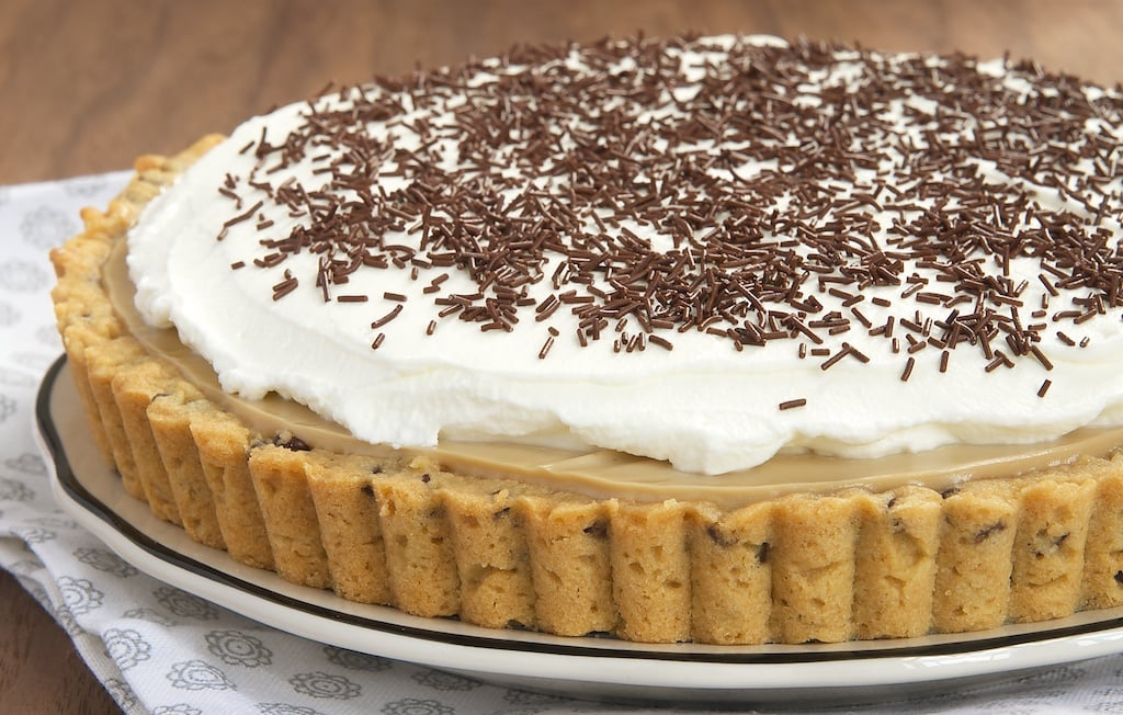 A chocolate chip cookie crust, my favorite homemade butterscotch pudding, and whipped cream combine for an irresistible dessert! - Bake or Break