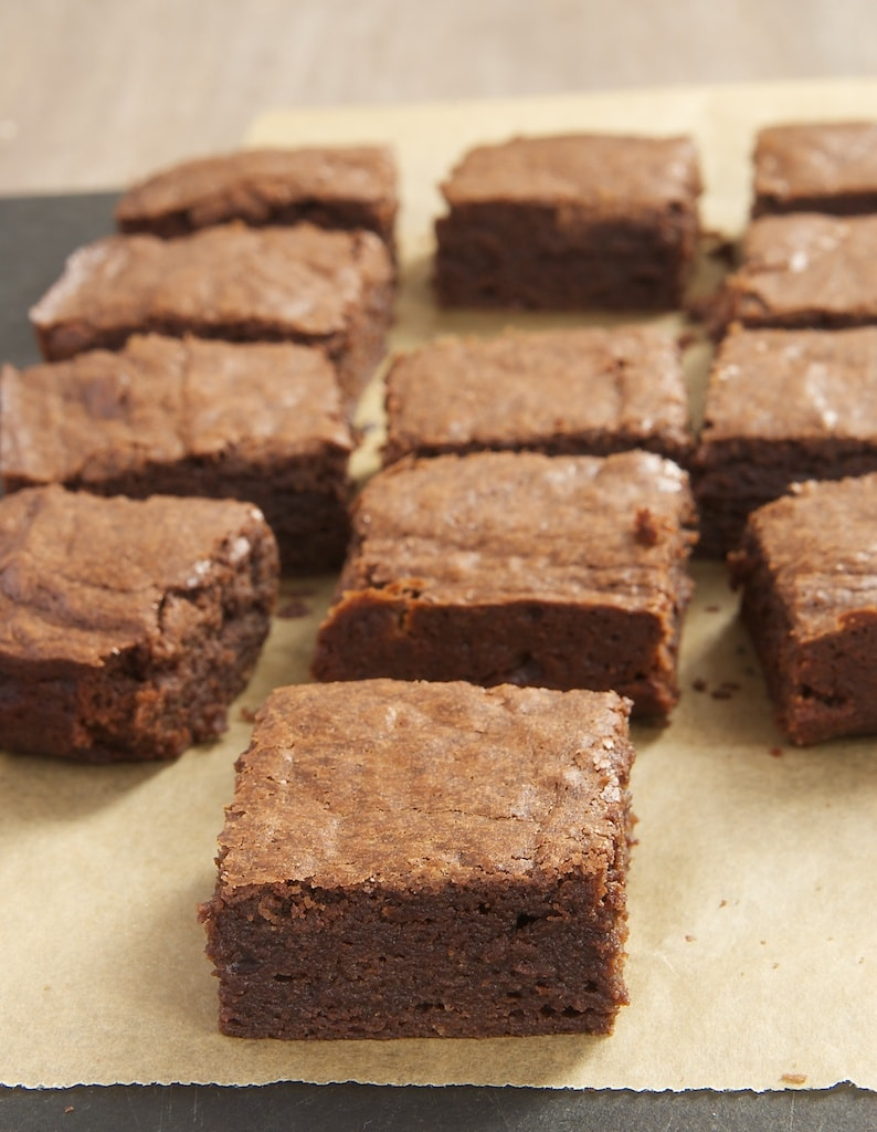 Freshly baked brownies are one of the dessert world's simple pleasures. My Favorite Fudgy Brownies are dark, rich, and utterly delicious!