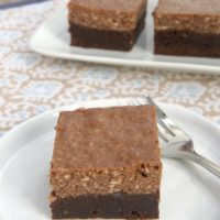 Brownies and cheesecake come together with chocolate and hazelnut to make these delicious Chocolate Hazelnut Cheesecake Brownies. - Bake or Break