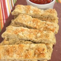 Italian Herb and Cheese Breadsticks are so simple to make with Krusteaz Flatbreads mixes! Serve with your favorite marinara for a great snack.
