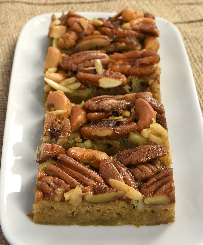 Maple syrup, your favorite nuts, a simple crust, and a gooey filling come together to make these delicious Maple Nut Bars!