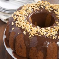 Peanut Butter Bundt Cake with Milk Chocolate Ganache is a must for fans of chocolate and peanut butter. This simple cake is as delicious as it is gorgeous! - Bake or Break