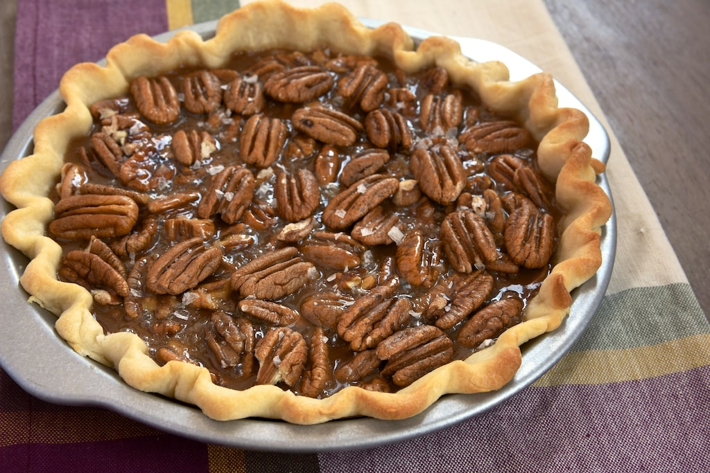 Rich, gooey, salty caramel and crunchy pecans make for a delicious, irresistible dessert. This Salted Caramel Pecan Pie is sure to be devoured quickly! - Bake or Break