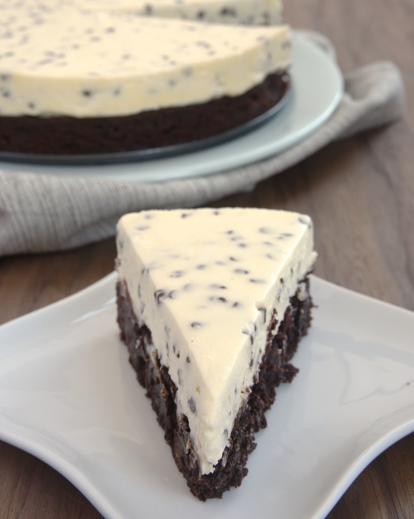 slice of Chocolate Chip Cheesecake on a square white plate