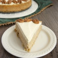 slice of Spiced Cheesecake with Oatmeal Cookie Crust on a white plate
