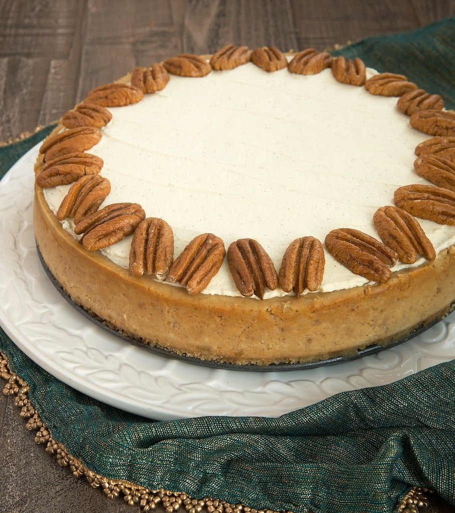 Spiced Cheesecake with Oatmeal Cookie Crust topped with toasted pecans