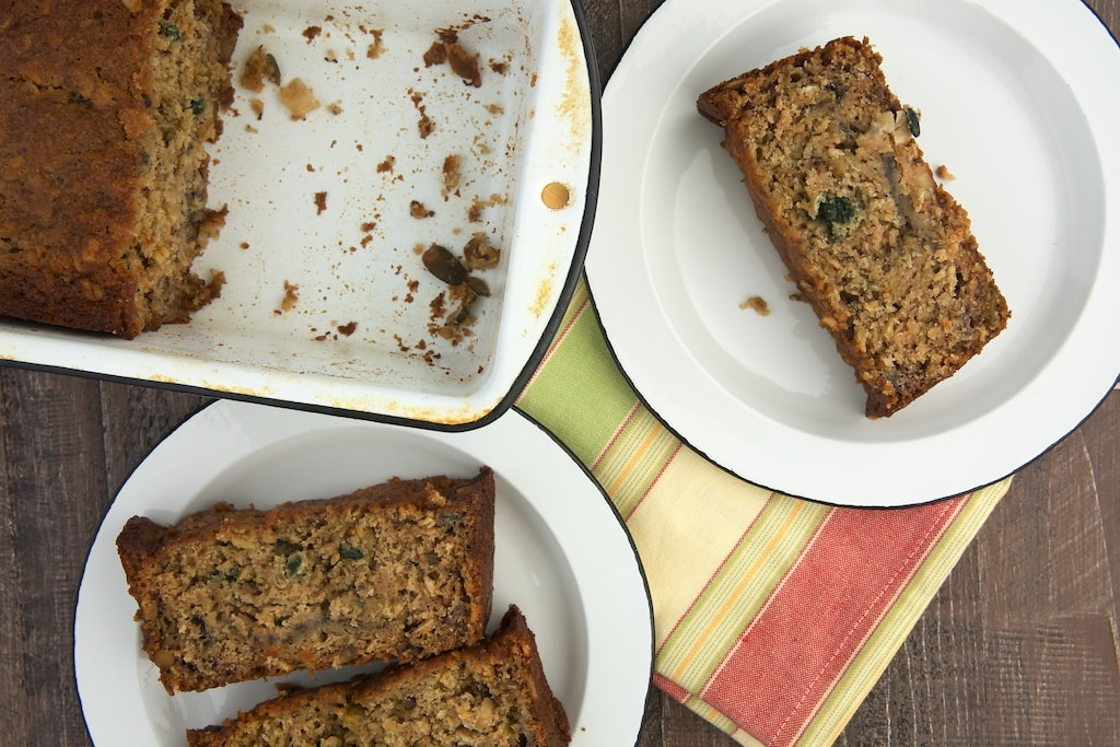 overhead view of slices of Granola Banana Bread on white plates