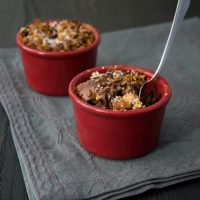 These little Dark Chocolate Bourbon Bread Puddings have big flavor with bourbon, chocolate, and pecans. - Bake or Break
