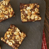 Dulce de Leche Cashew Brownies on a granite board