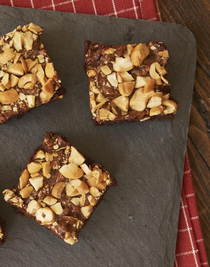 Dulce de Leche Cashew Brownies on a granite board