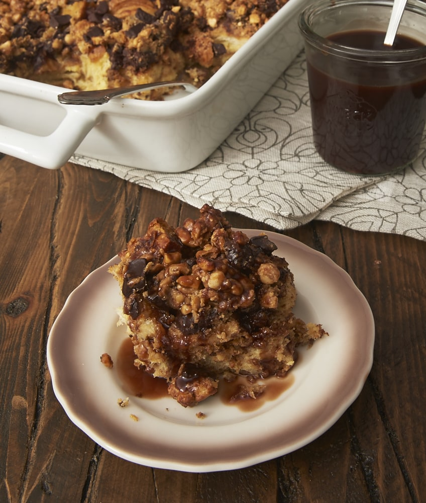 Peanut Butter Chocolate Bread Pudding served on a brown-rimmed white plate