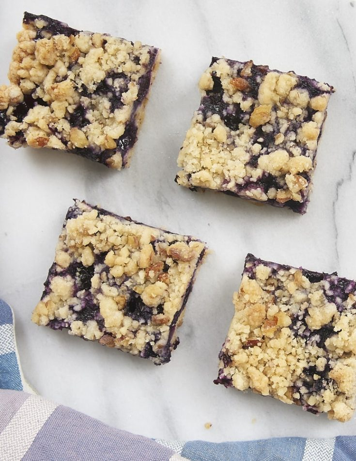 Blueberry Pecan Shortbread Bars on a marble serving board