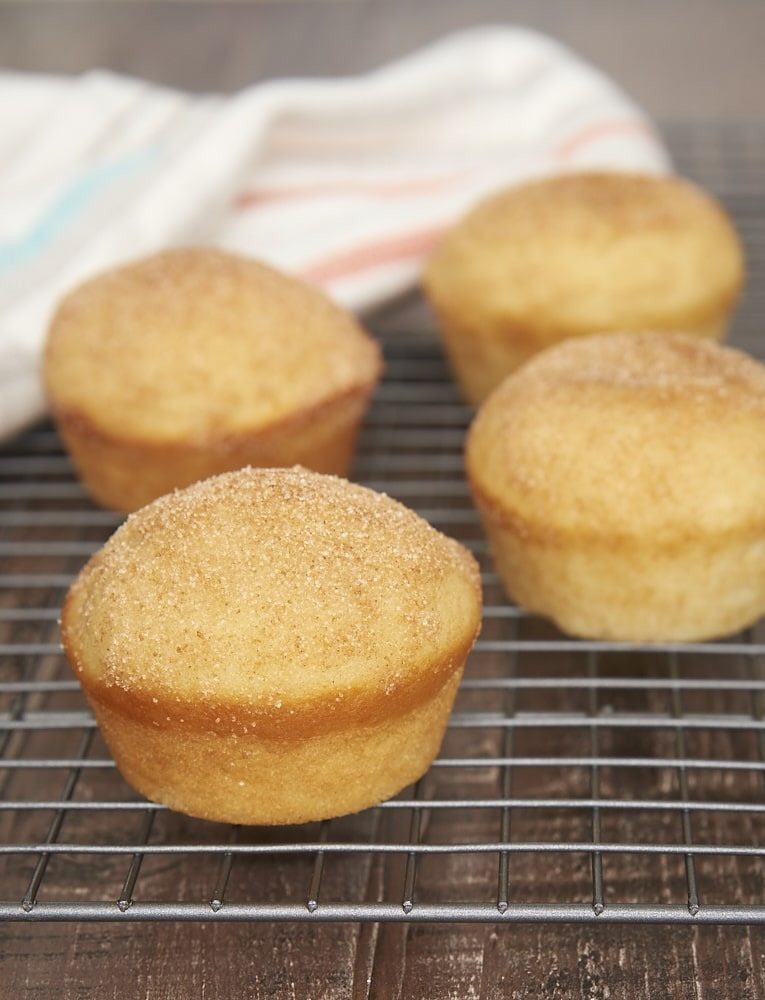 Jam-Filled Doughnut Muffins on a wire cooling rack