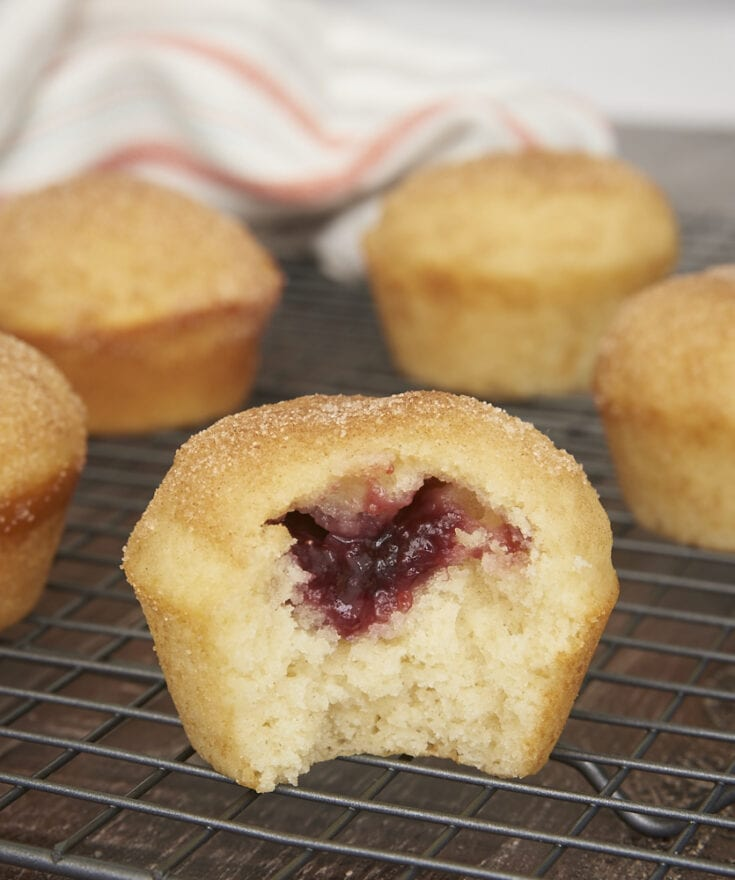 Jam-Filled Doughnut Muffin with a bite missing to show the jam inside