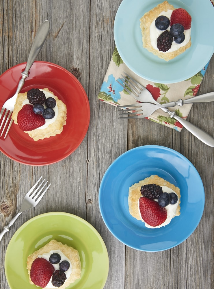 Puff pastry, a creamy filling, and fresh berries come together quickly and simply to make these luscious Berries and Cream Tartlets. - Bake or Break