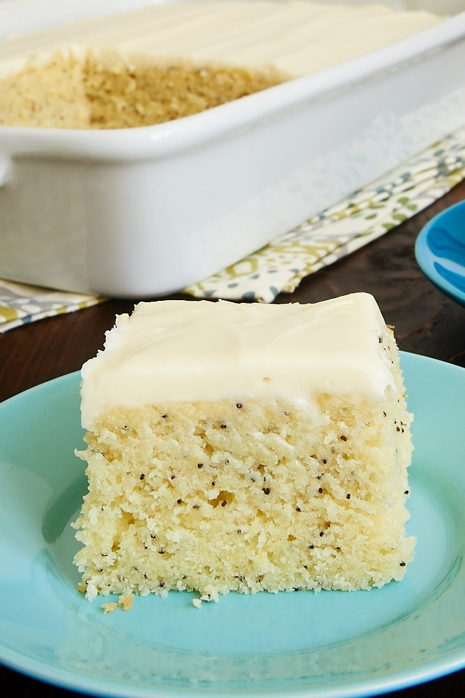 slice of Lemon Poppy Seed Cake on a blue plate