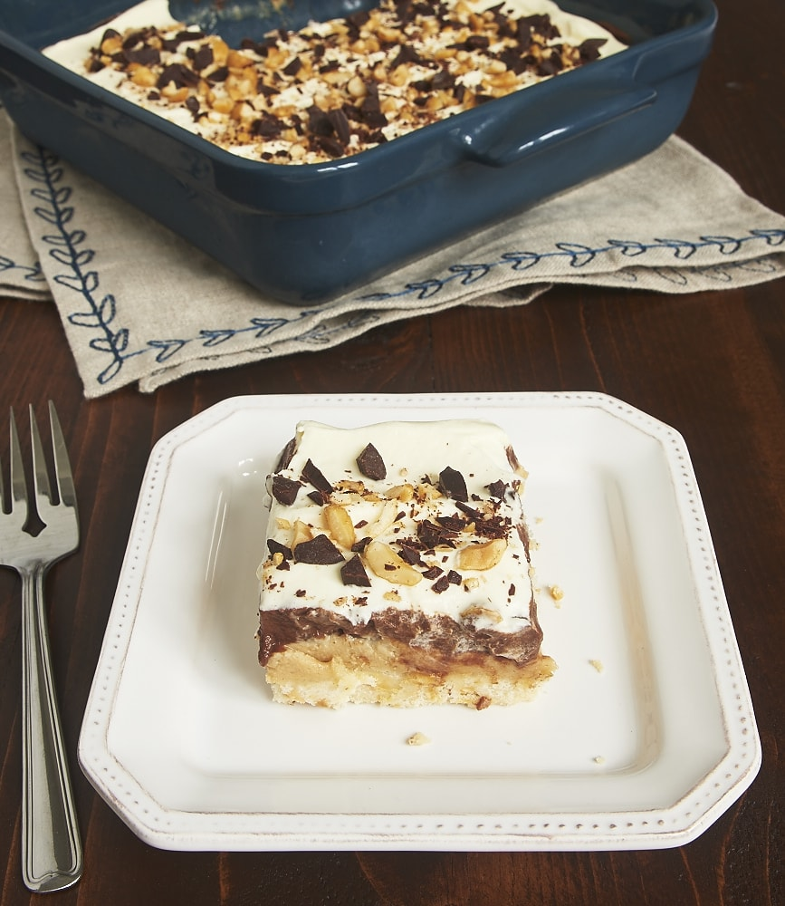 Layers of shortbread, peanut butter, chocolate pudding, and whipped cream make this Peanut Butter Chocolate Delight irresistible! - Bake or Break