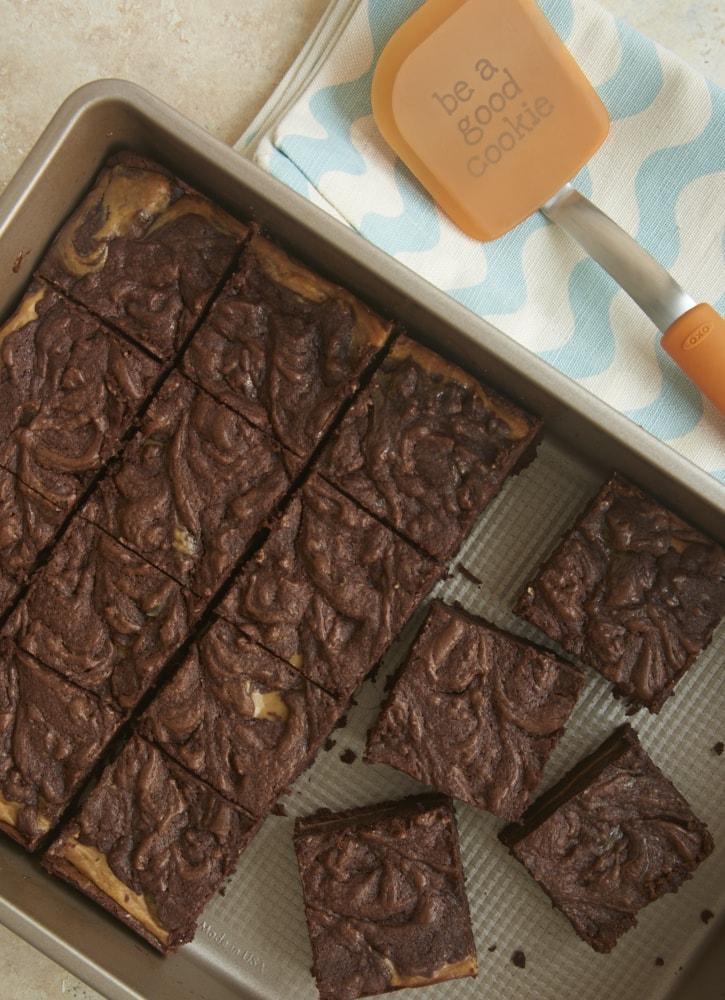 overhead view of Dulce de Leche Cheesecake Brownies in a metal baking pan
