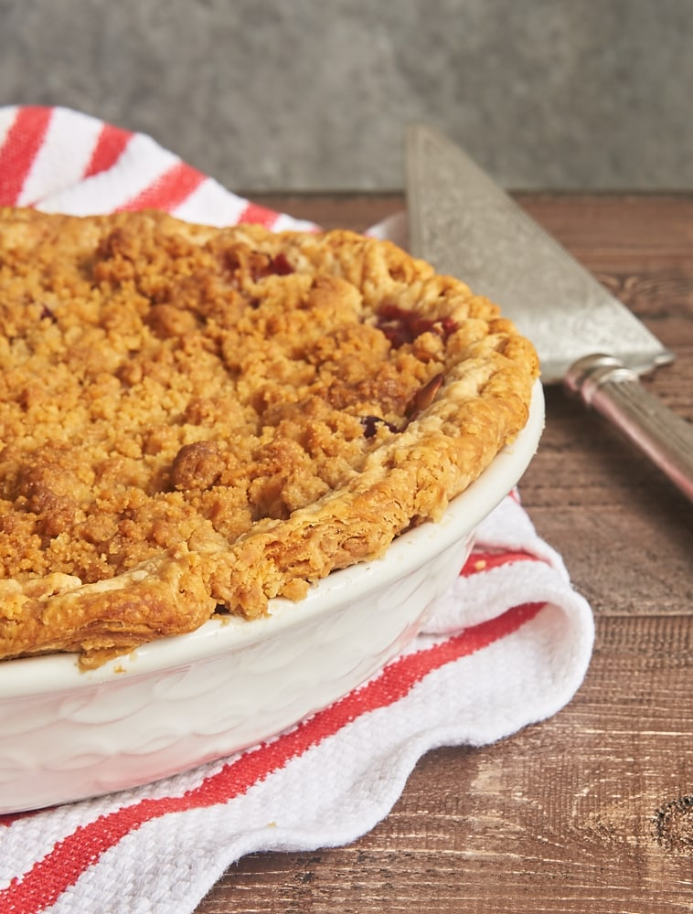 Apple Cranberry Crumb Pie is a sweet, tart, absolutely delicious pie. That fruity filling and a sweet, buttery crumb topping make this one irresistible dessert! - Bake or Break