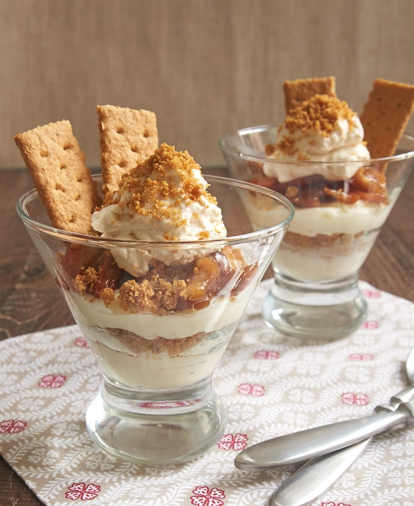 No-Bake Apple Cheesecakes topped with whipped cream and graham crackers