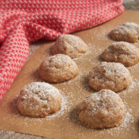Toffee Pecan Snowdrop Cookies on parchment paper