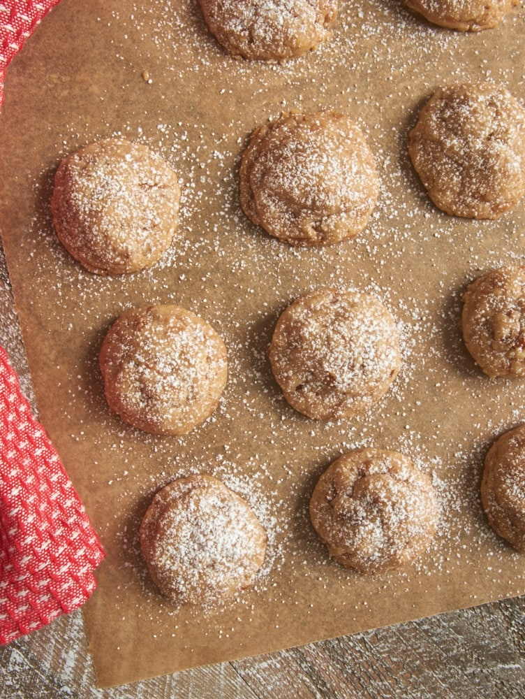 Toffee Pecan Snowdrop Cookies sprinkled with confectioners' sugar