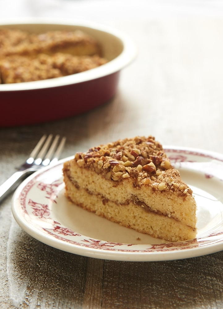 slice of Brown Butter Pecan Coffee Cake on a red floral-rimmed white plate