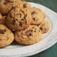 Peanut Butter Chocolate Chip Crunch Cookies on a white and gray plate