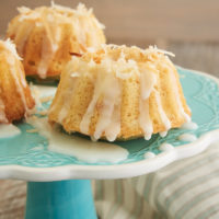 Mini Coconut Bundt Cakes topped with a simple glaze and toasted coconut
