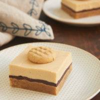 Peanut Butter Cheesecake Bars topped with a mini peanut butter cookie