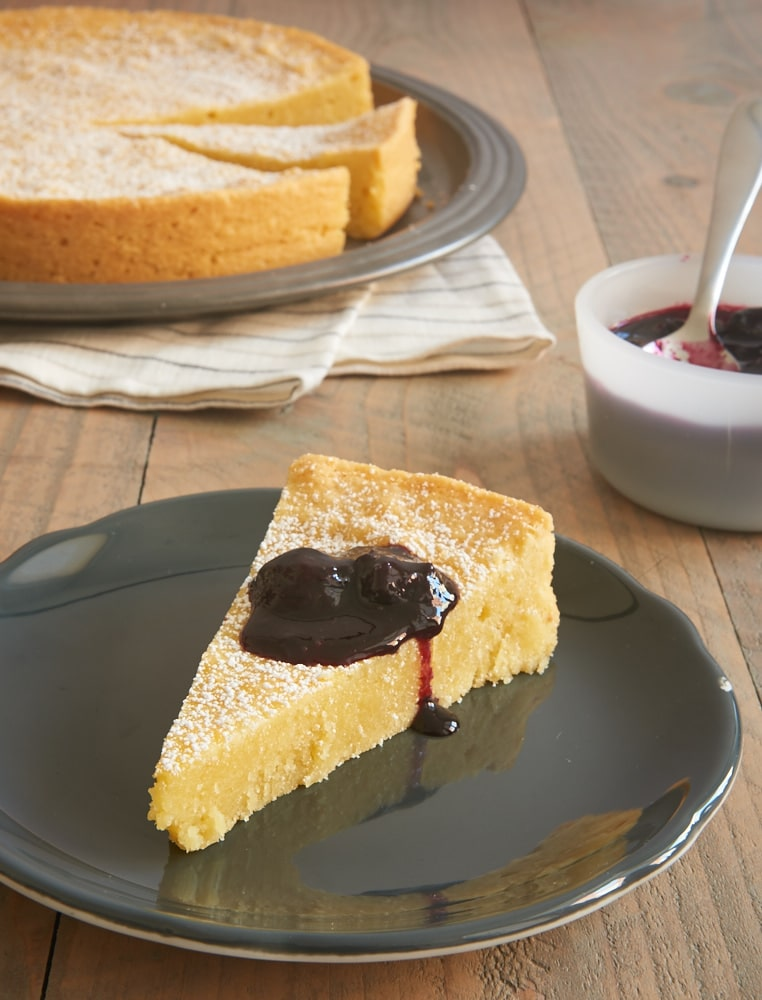 slice of Almond Gateau Breton topped with blueberry compote