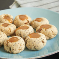 Almond Poppy Seed Thumbprint Cookies are simple, nutty cookies filled with caramel. Or try filling them with your favorite fruit preserves or nut butter! - Bake or Break