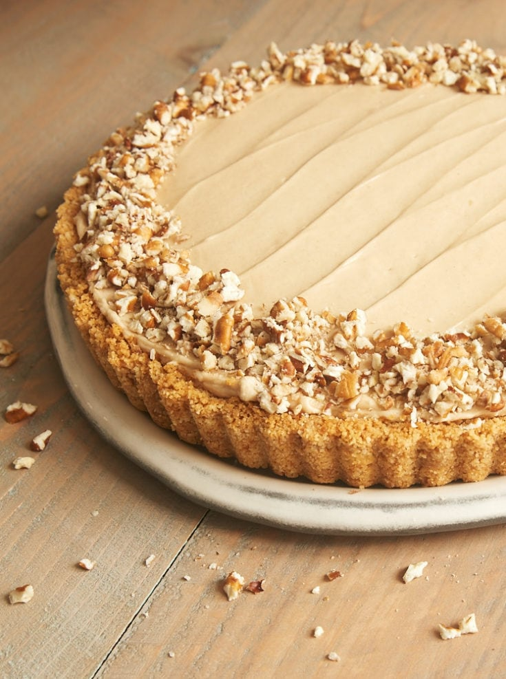 Brown Sugar Banana No-Bake Cheesecake topped with chopped pecans
