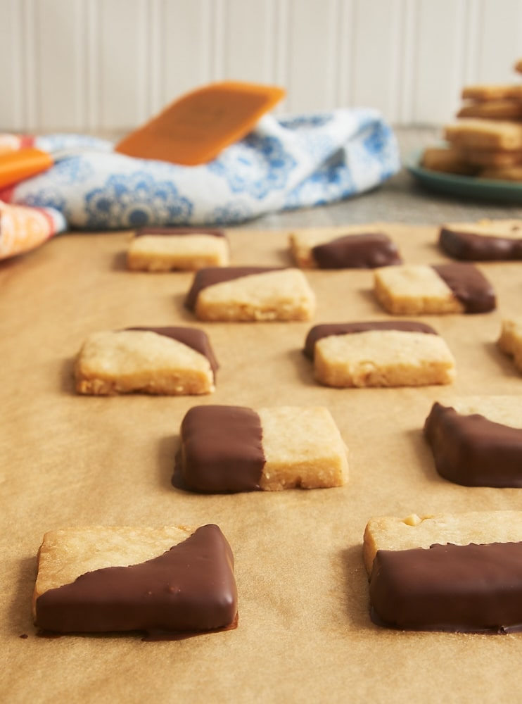 Nutty shortbread and dark chocolate are a perfect pair in these Chocolate-Dipped Hazelnut Shortbread. - Bake or Break