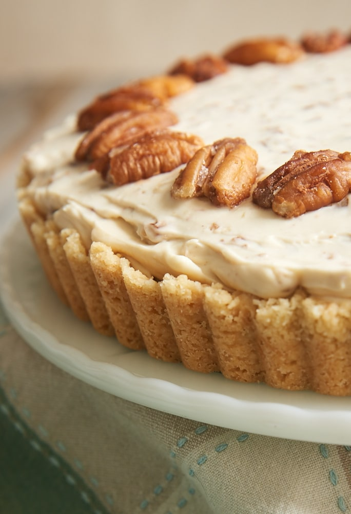 Butter Pecan Cheesecake topped with toasted pecans