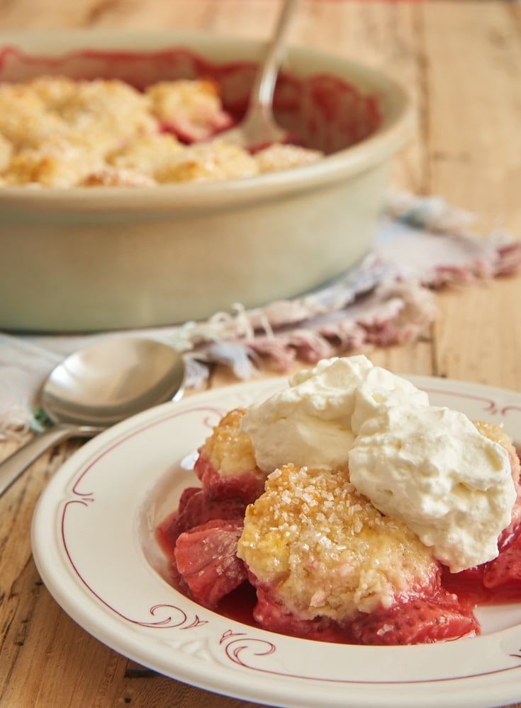Strawberry Cobbler topped with sweetened whipped cream