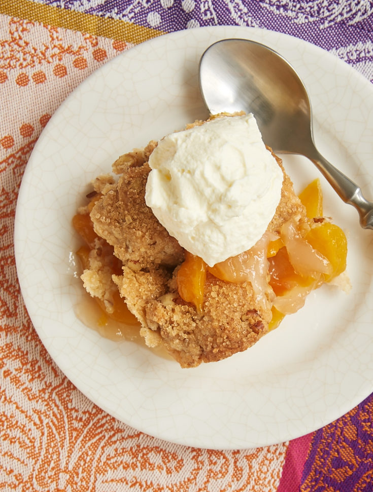 Ginger adds a bit of spice, and pecans contribute some crunch to this fantastic Ginger Pecan Peach Cobbler. - Bake or Break