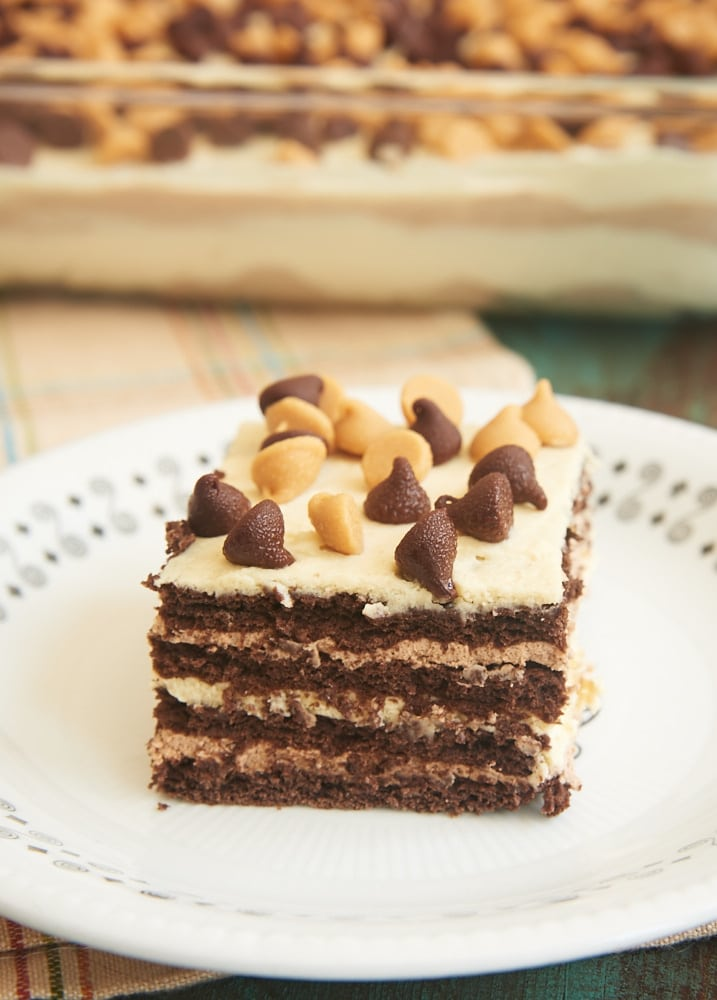 Chocolate Peanut Butter Icebox Cake features delicious layers of chocolate graham crackers, chocolate whipped cream, and peanut butter whipped cream. A quick and easy must-make for chocolate and peanut butter lovers! - Bake or Break