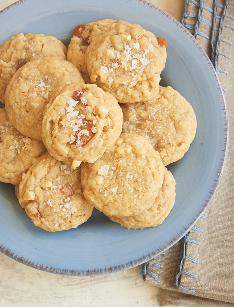 Rich caramel and crunchy cashews add big flavor to these Salty Cashew Caramel Cookies. The sprinkle of salt on top makes them even better! - Bake or Break