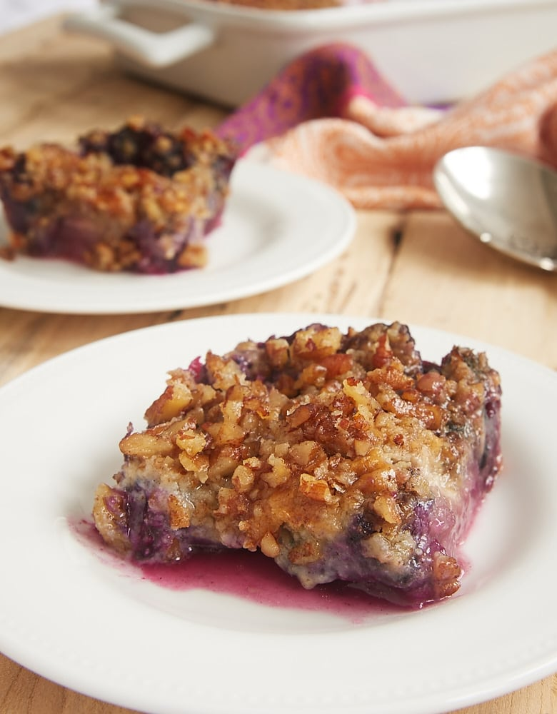 Blueberry Pineapple Dump Cake served on a white plate