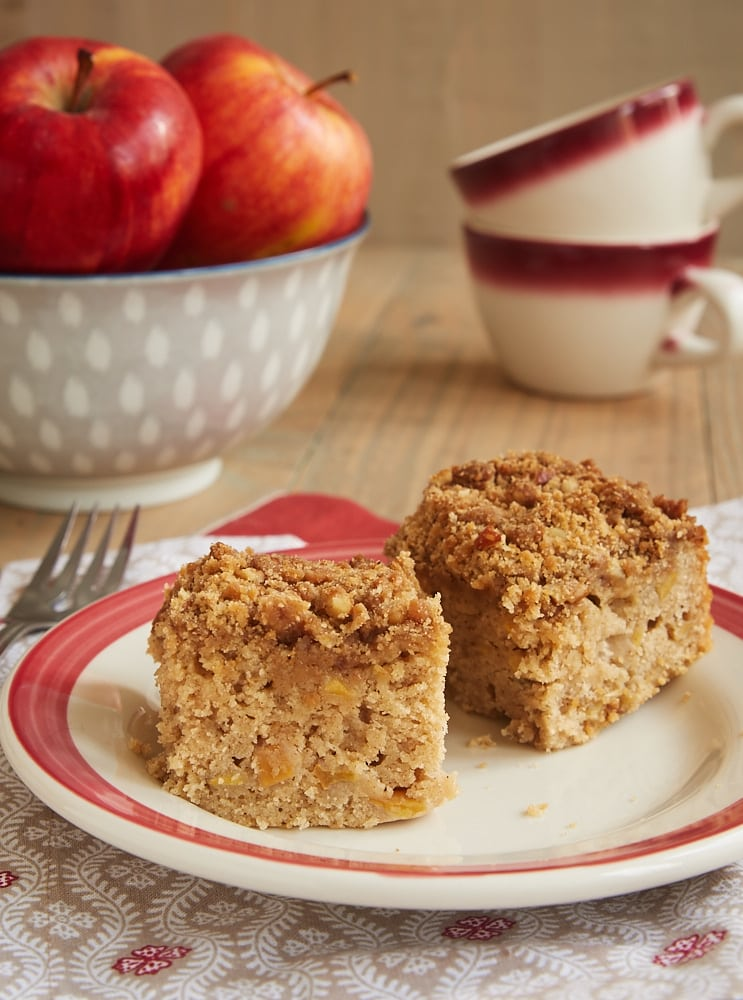 two slices of Caramel Apple Crumb Cake on a red-rimmed white plate
